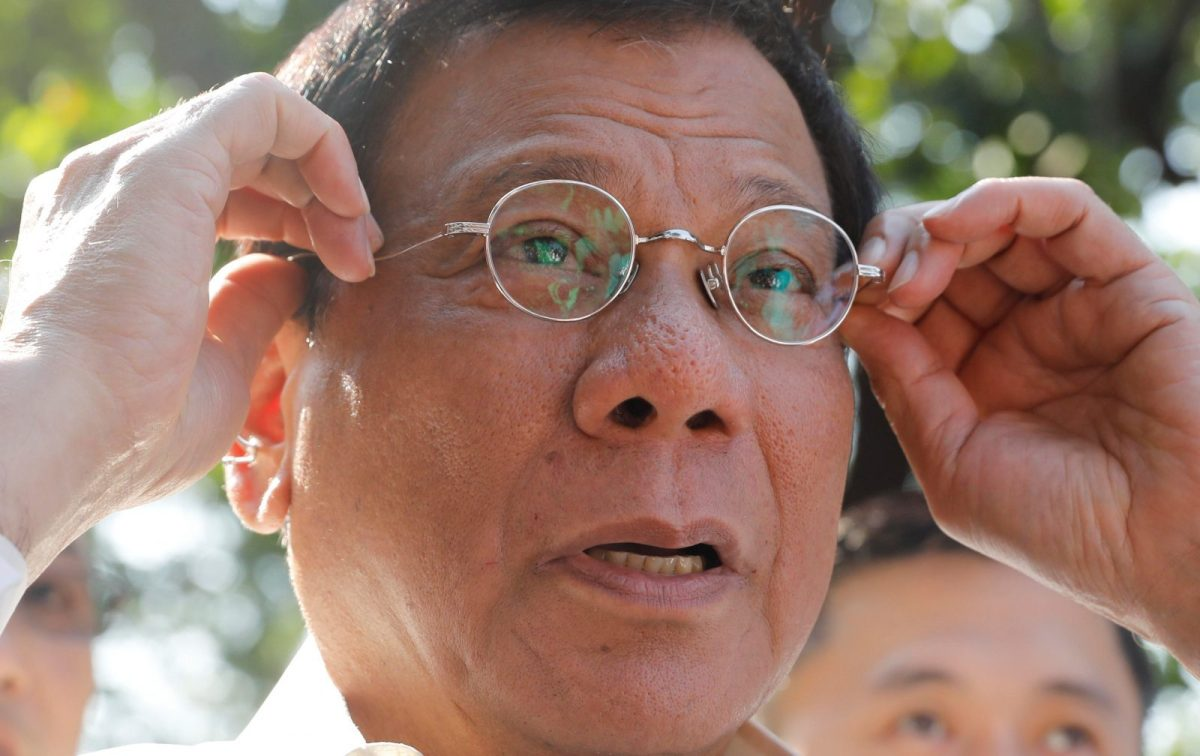 Philippine President Rodrigo Duterte holds his glasses as he speaks to reporters at the presidential palace in Manila, Philippines April 28, 2017. Photo: Reuters/Erik De Castro