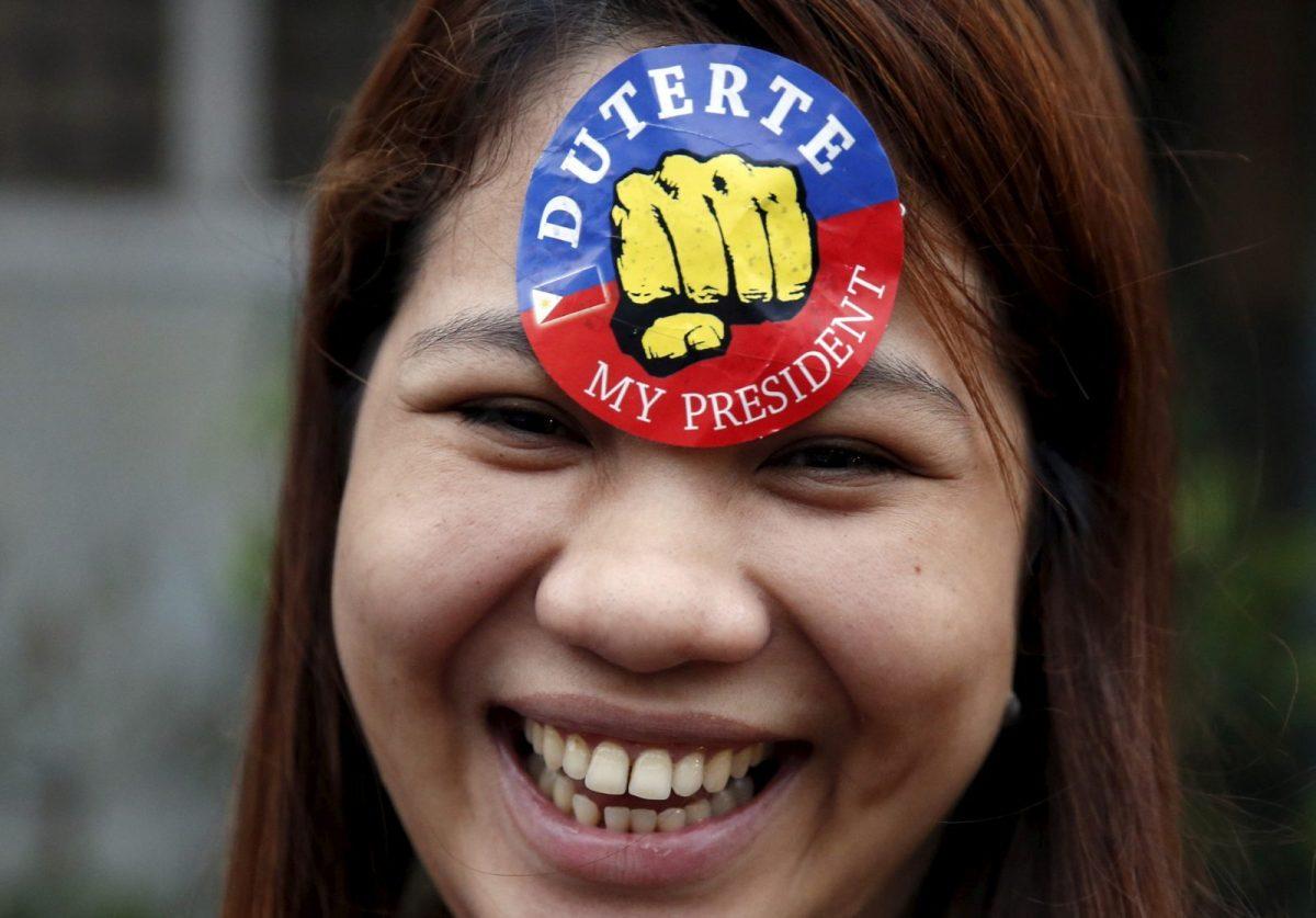 A supporter of President Rodrigo Duterte is pictured during presidential election campaigning in Malabon, Metro Manila in the Philippines April 27, 2016. Reuters/Erik De Castro