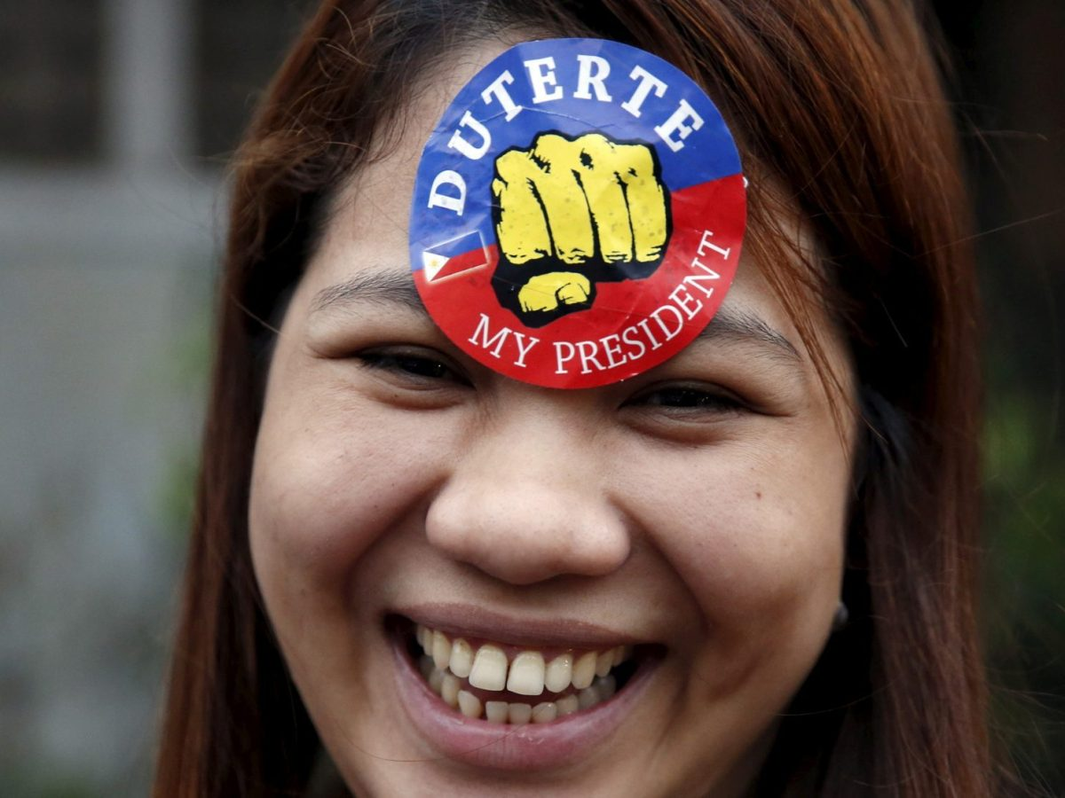 A supporter of President Rodrigo Duterte is pictured during presidential election campaigning in Malabon, Metro Manila in the Philippines April 27, 2016. Reuters/Erik De Castro