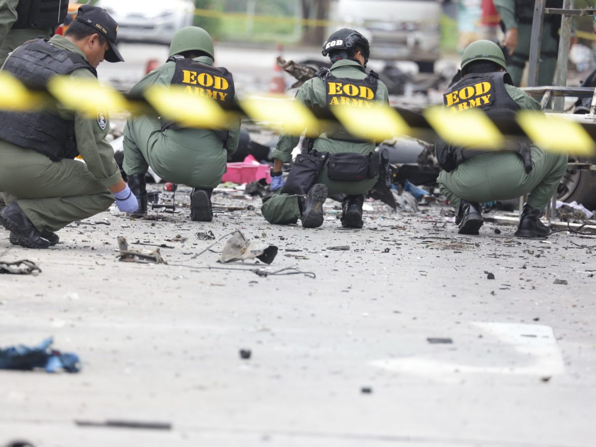 """Thai Army investigators examine the site of where a bomb was detonated in the southern city of Pattani, in southern Thailand on May 10, 2017. More than 50 people were wounded on May 9 when a car bomb exploded outside a supermarket in Thailand's insurgency plagued south, police said, the largest attack for months on a civilian target in the troubled zone. Photo: AFP/ Tuwaedaniya """""""