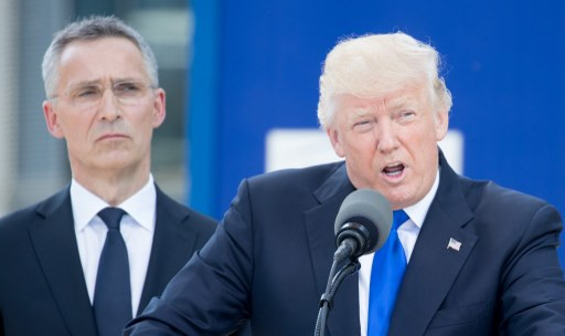 President Trump speaking next to NATO Secretary General Jens Stoltenberg during the opening of the new NATO headquarters. Photo: Kay Nietfeld/dpa