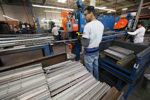 Workers build bed frames at the Hollywood Bed Frame Company factory in Commerce, California. Photo: Reuters/Robyn Beck