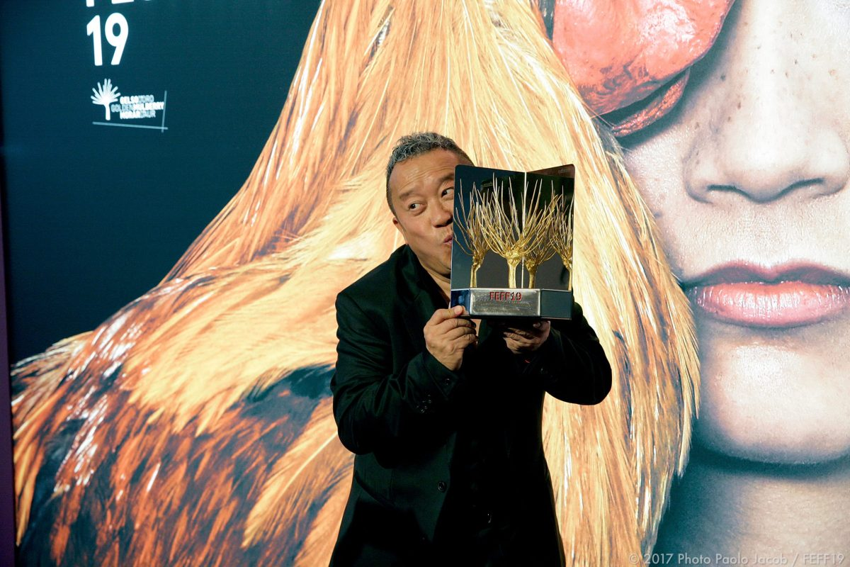 Eric Tsang with his Golden Mulberry. Photo: FEFF