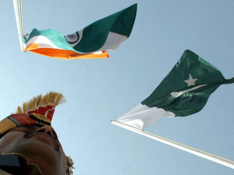 An Indian border guard stands near Indian and Pakistani flags during a fair at Chamliyal in Jammu and Kashmir. Photo: Reuters