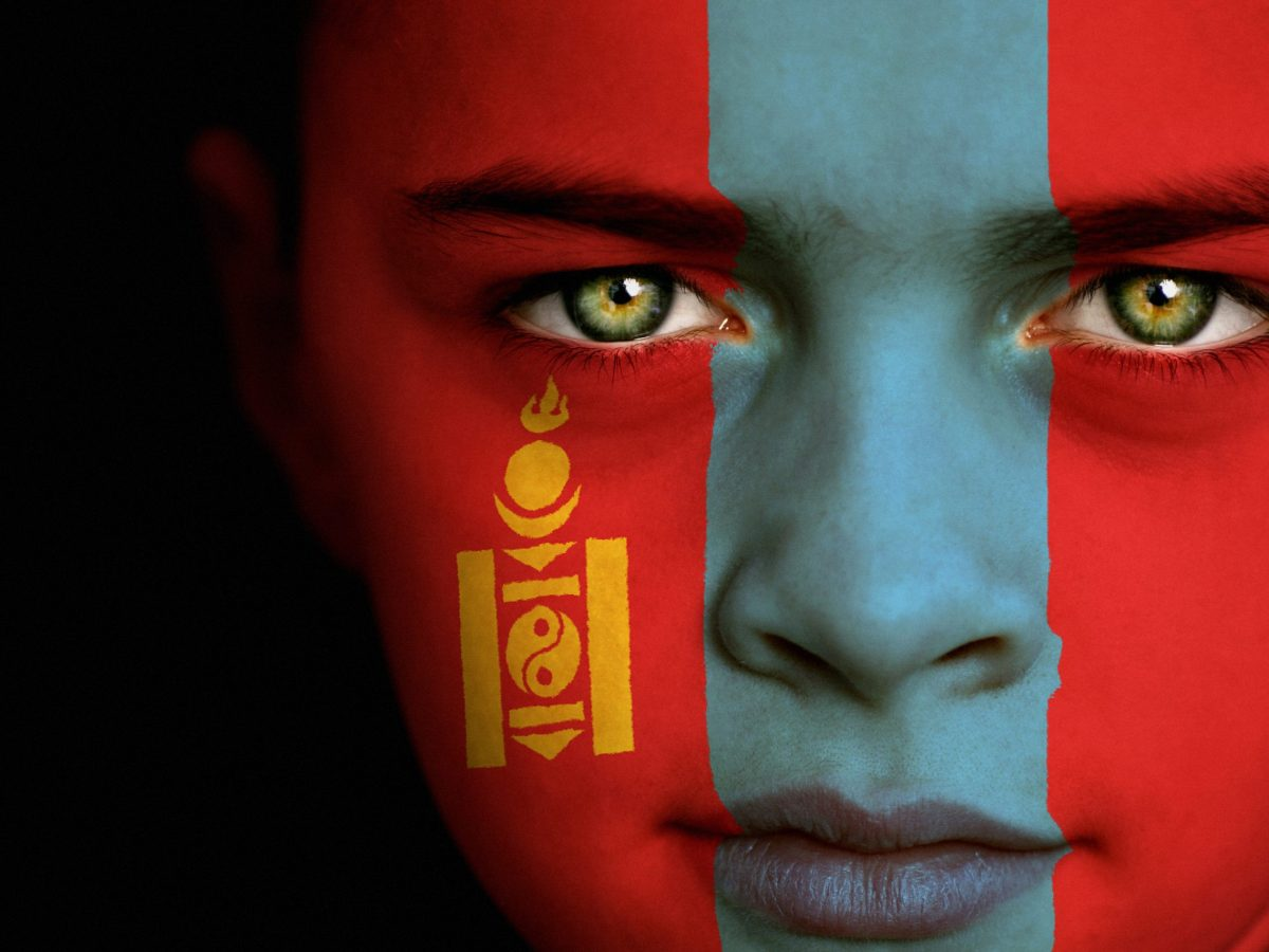 Portrait of a boy with the flag of Mongolia painted on his face. Photo: iStock