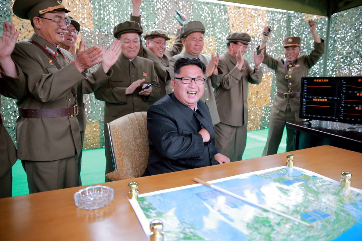 Kim Jong Un reacts  during a test launch of ground-to-ground medium long-range ballistic rocket Hwasong-10 in June 2016.  Photo: Reuters via KCNA