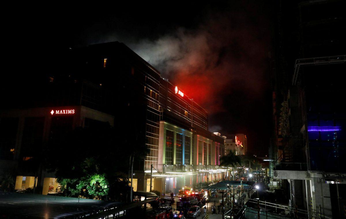 Smoke billows from the Resorts World building in Pasay City, Metro Manila. Photo: Reuters/Erik De Castro