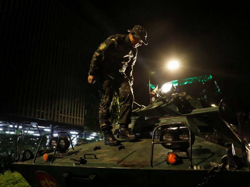 A policeman alights from an armored fighting vehicle (AFV) near the Resorts World Manila in Pasay City. Photo: Reuters/Erik De Castro
