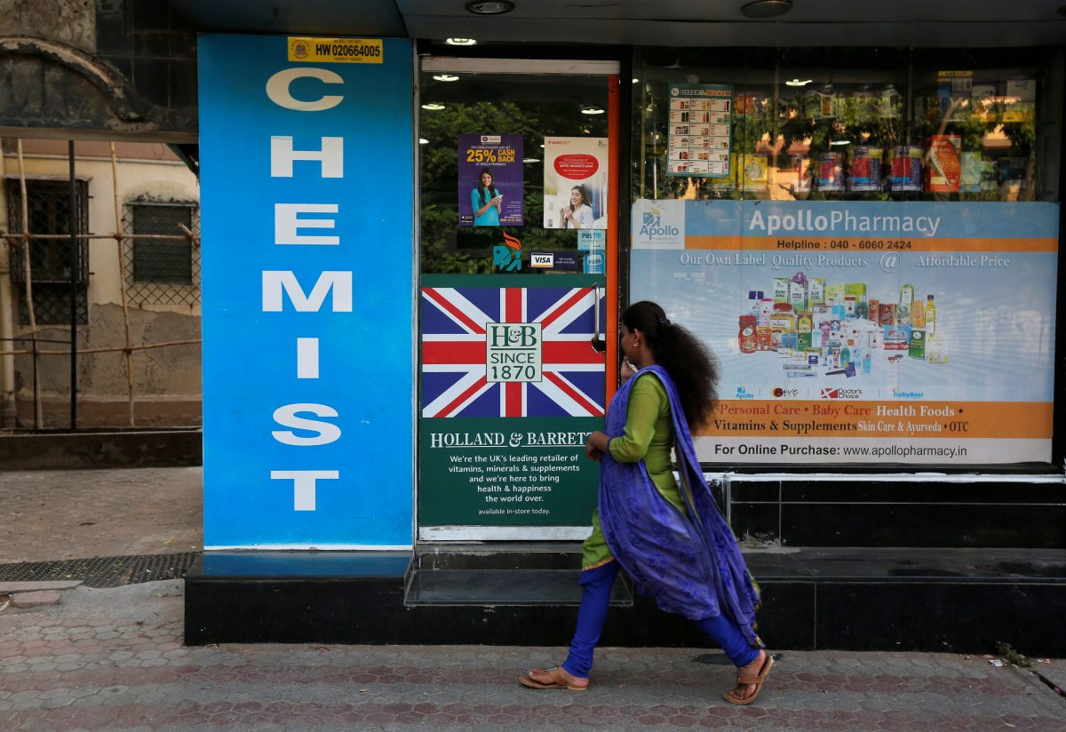 A woman walks past a chemist shop in Mumbai, India. Photo: Reuters/Shailesh Andrade