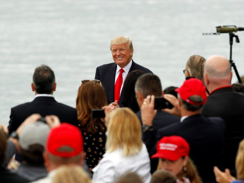 US President Donald Trump smiles as he arrives for rally along side the Ohio River at the Rivertowne Marina in Cincinnati. Photo: Reuters/John Sommers II
