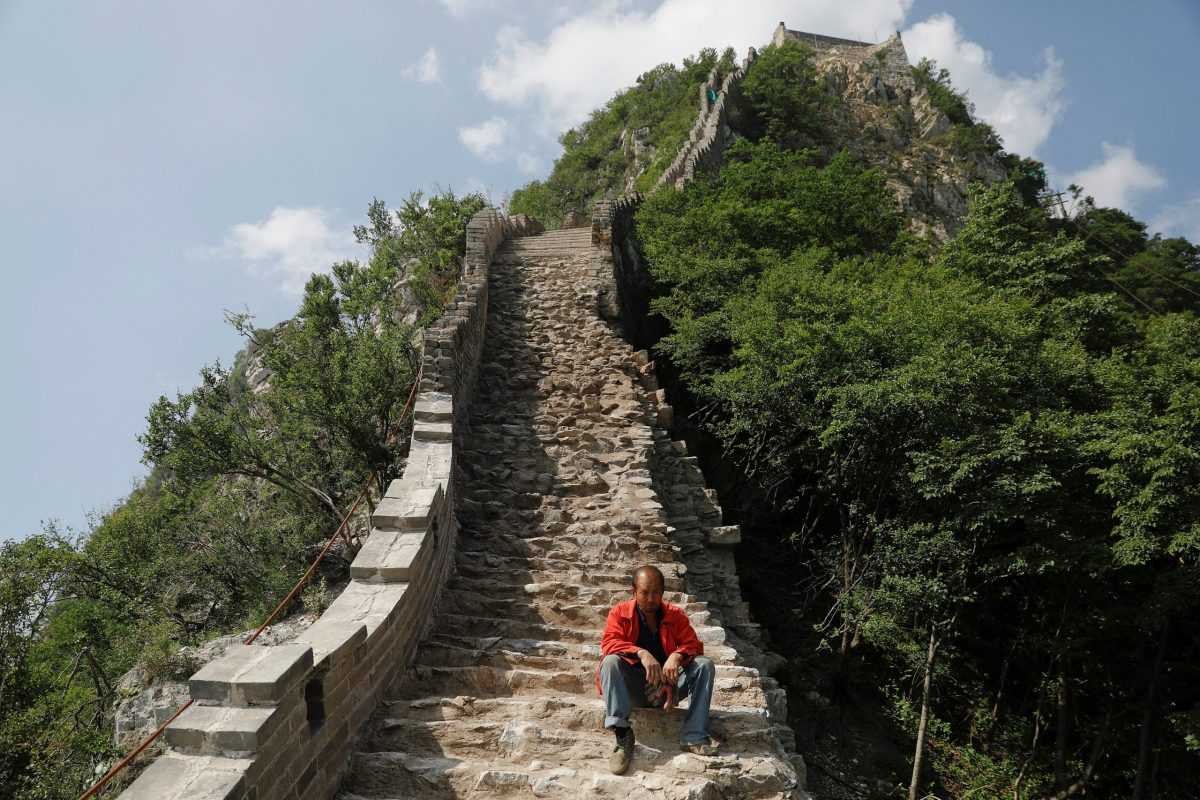 A man rests while working on the reconstruction of the Jiankou section of the Great Wall. Photo: Reuters/Damir Sagolj