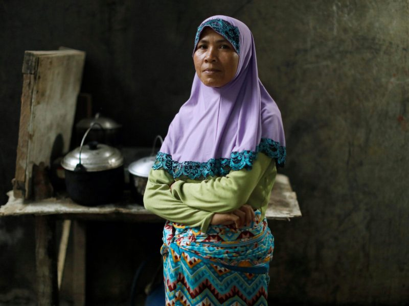 An evacuated woman cooking in a refugee centre in Iligan, while government forces fight insurgents from the Maute group in Marawi city. Photo: Reuters/Jorge Silva