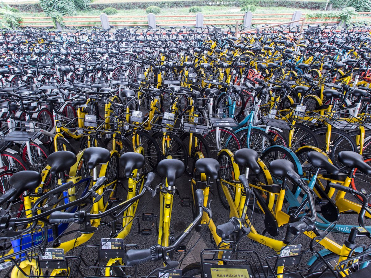 Bicycles of various sharing services are seen under an overpass in Hangzhou, Zhejiang province, China, on June 7, 2017. Photo: Reuters/Stringer