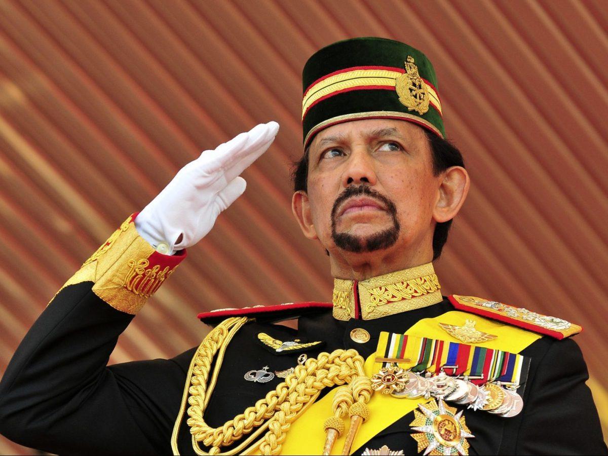 Brunei's Sultan Hassanal Bolkiah salutes the royal guard of honor during his 65th birthday celebrations in Bandar Seri Begawan. Photo: Reuters/Ahim Rani
