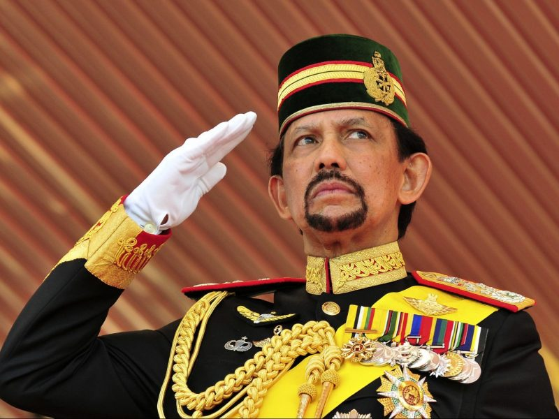 Brunei's Sultan Hassanal Bolkiah salutes the royal guard of honor during his 65th birthday celebrations in Bandar Seri Begawan. Photo: Reuters/Ahim Rani