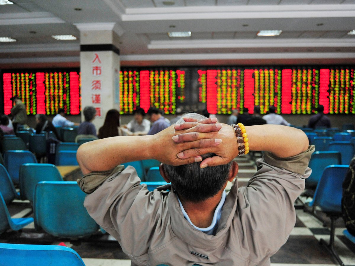 An investor watches a stock information board in Nanjing on May 24, 2017. Photo: Reuters/Stringer