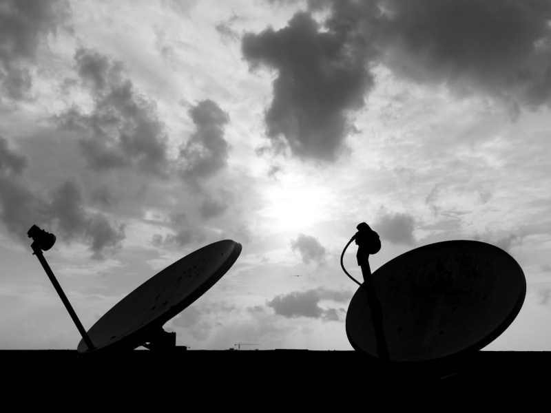 Direct-to-home television, as illustrated in this June 2015 photo taken atop an apartment building in Bangalore, has made big strides in India, but media freedom can come under attack. Photo: iStock