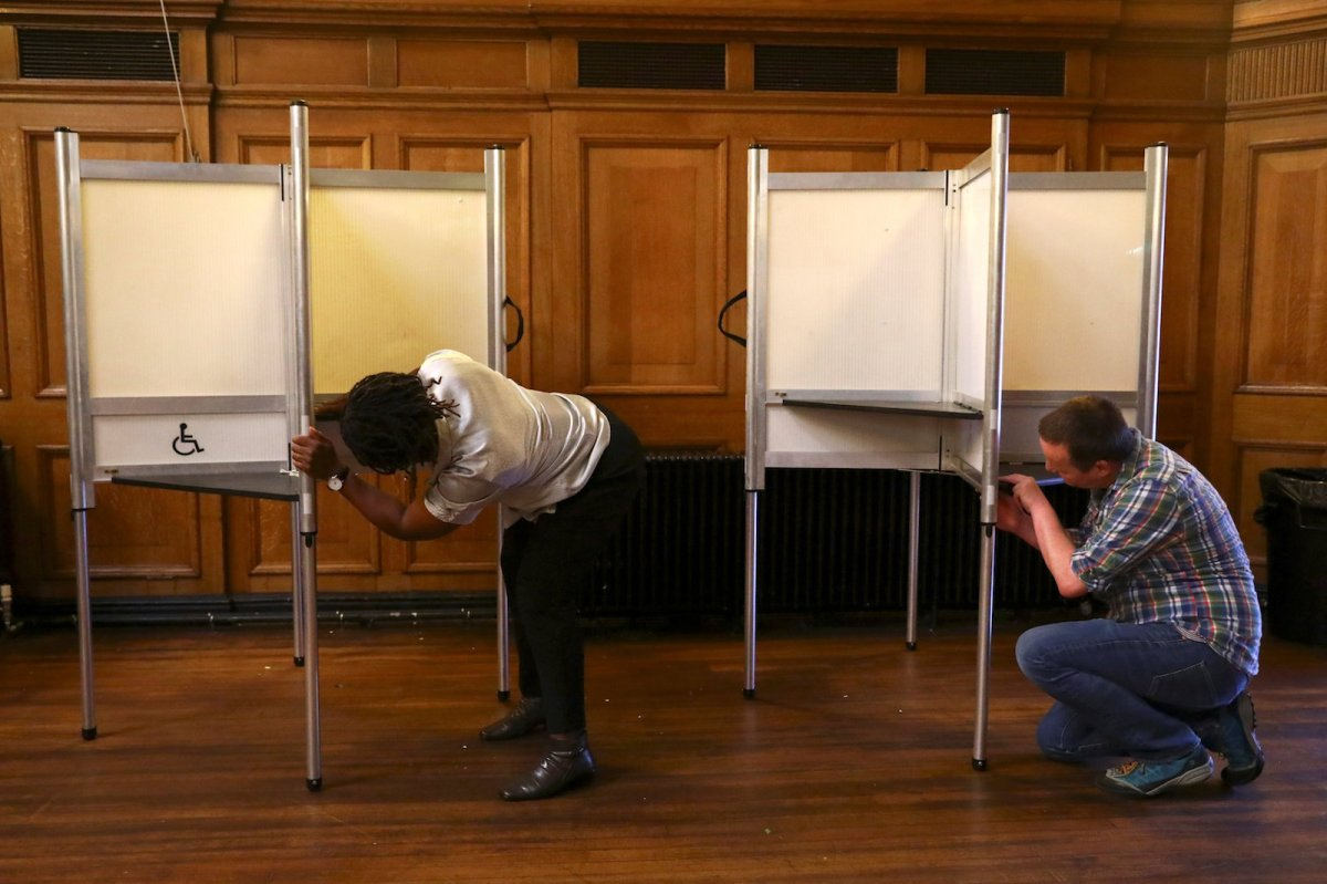 Workers assemble polling booths in London ahead of the UK general election on June 8, 2017. Photo: Reuters/Neil Hall