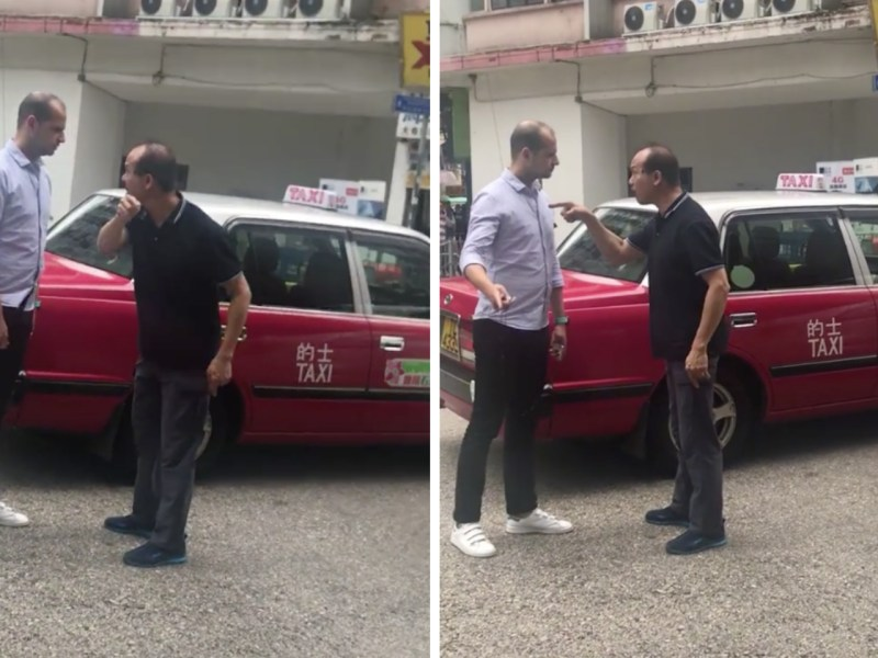 The taxi driver (right) scolds a pedestrian who allegedly made contact with his vehicle while jaywalking. Photo: Robin Lo@ Facebook