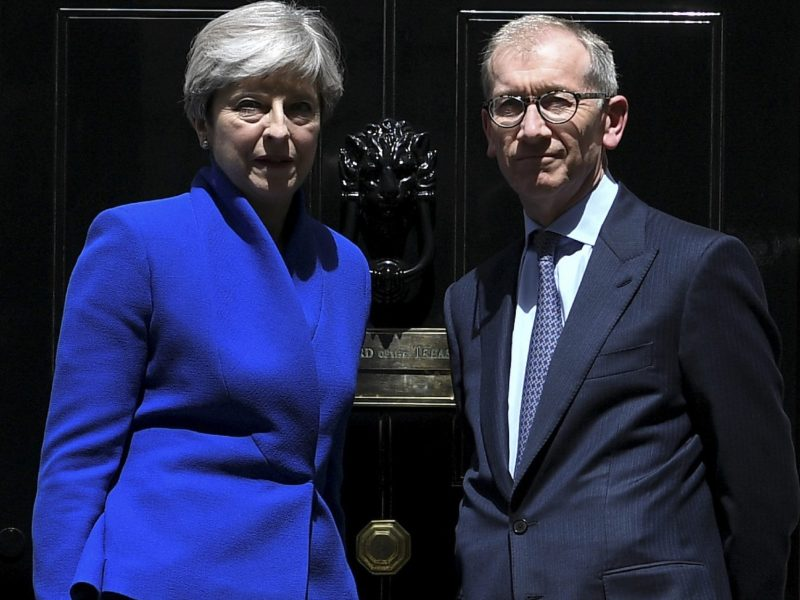 Britain's Prime Minister and leader of the Conservative Party Theresa May, with her husband Philip (R) outside 10 Downing Street. May is resisting pressure to resign after losing her parliamentary majority ahead of crucial Brexit talks. Photo: AGENCE FRANCE-PRESSE