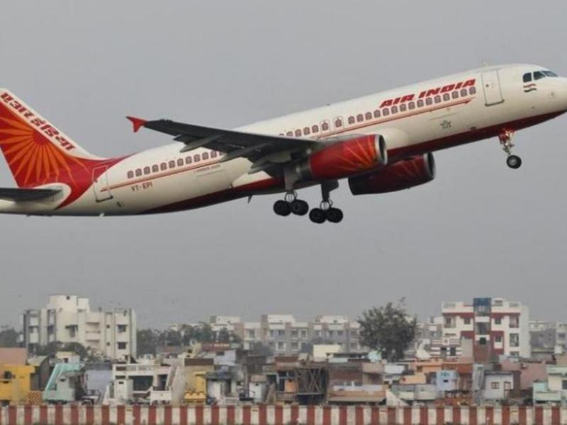 An Air India passenger plane takes off from Sardar Vallabhbhai Patel International Airport in Ahmedabad _ Reuters