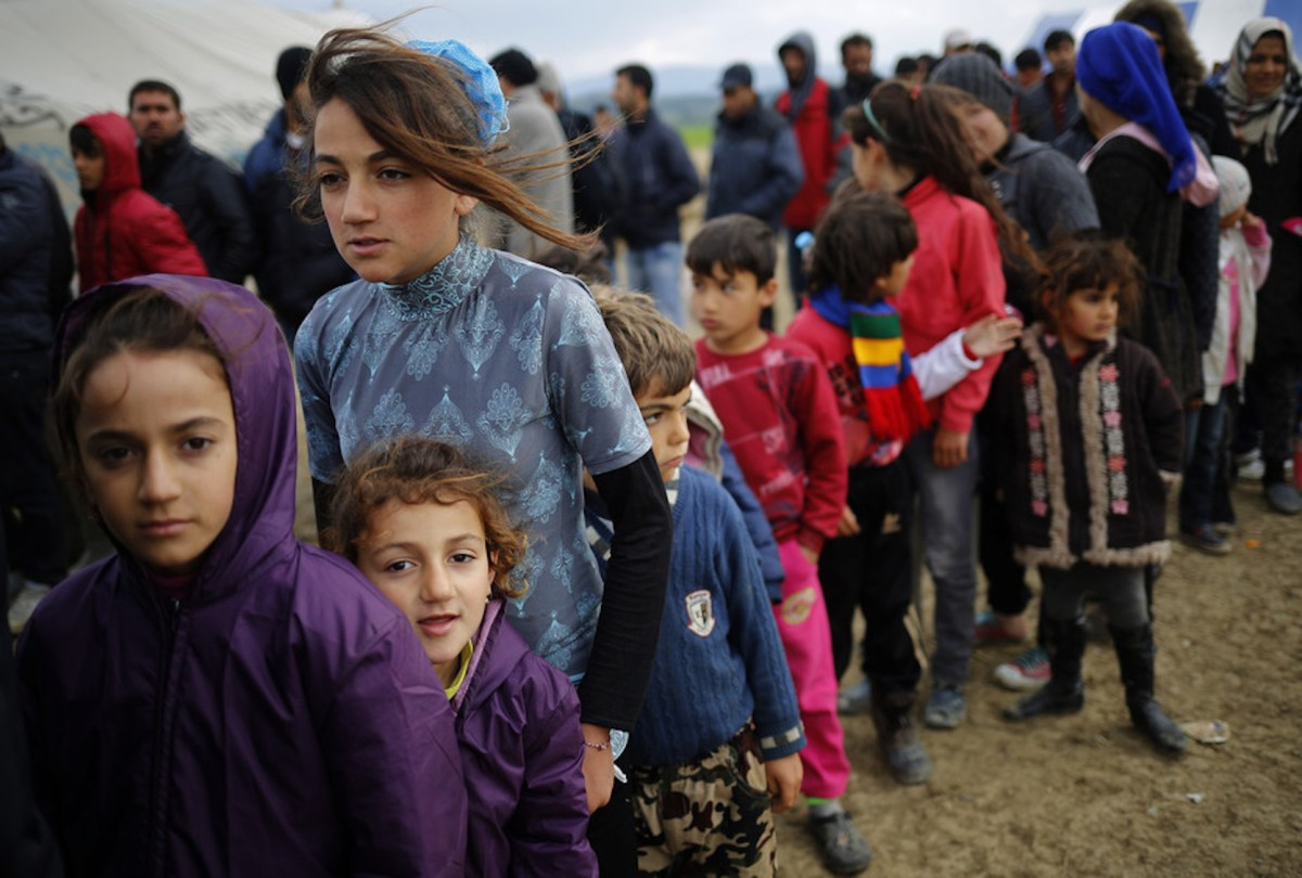 Refugees or migrants? When it comes to children who cross international borders without papers, there's no easy answer. Photo: Reuters/Stoyan Nenov
