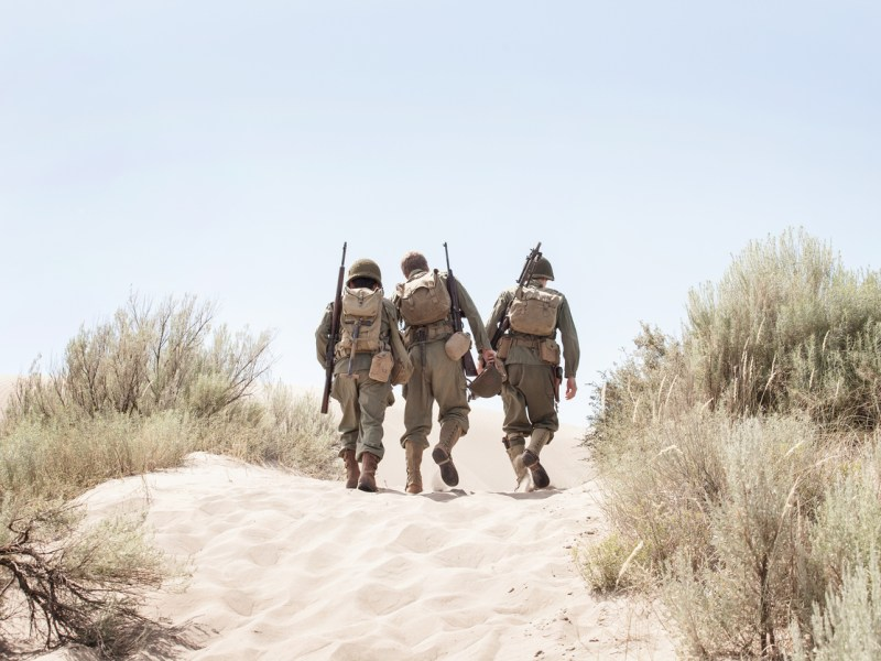 Image of WWII US Soldiers Walking into the desert. Photo: iStock