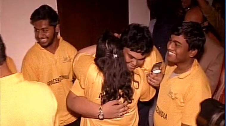 Students who built the world's smallest satellite celebrate  after its launch. Photo: ANI
