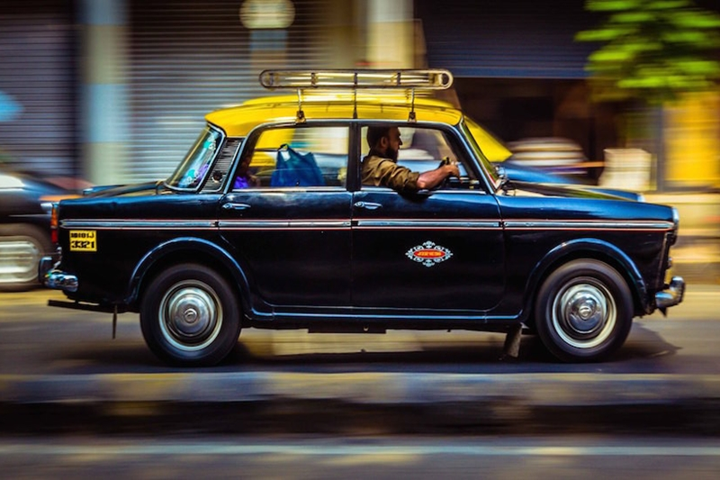 A new app allows commuters to hail Mumbai's famous back-and-yellow taxis. Photo: Free Press Journal