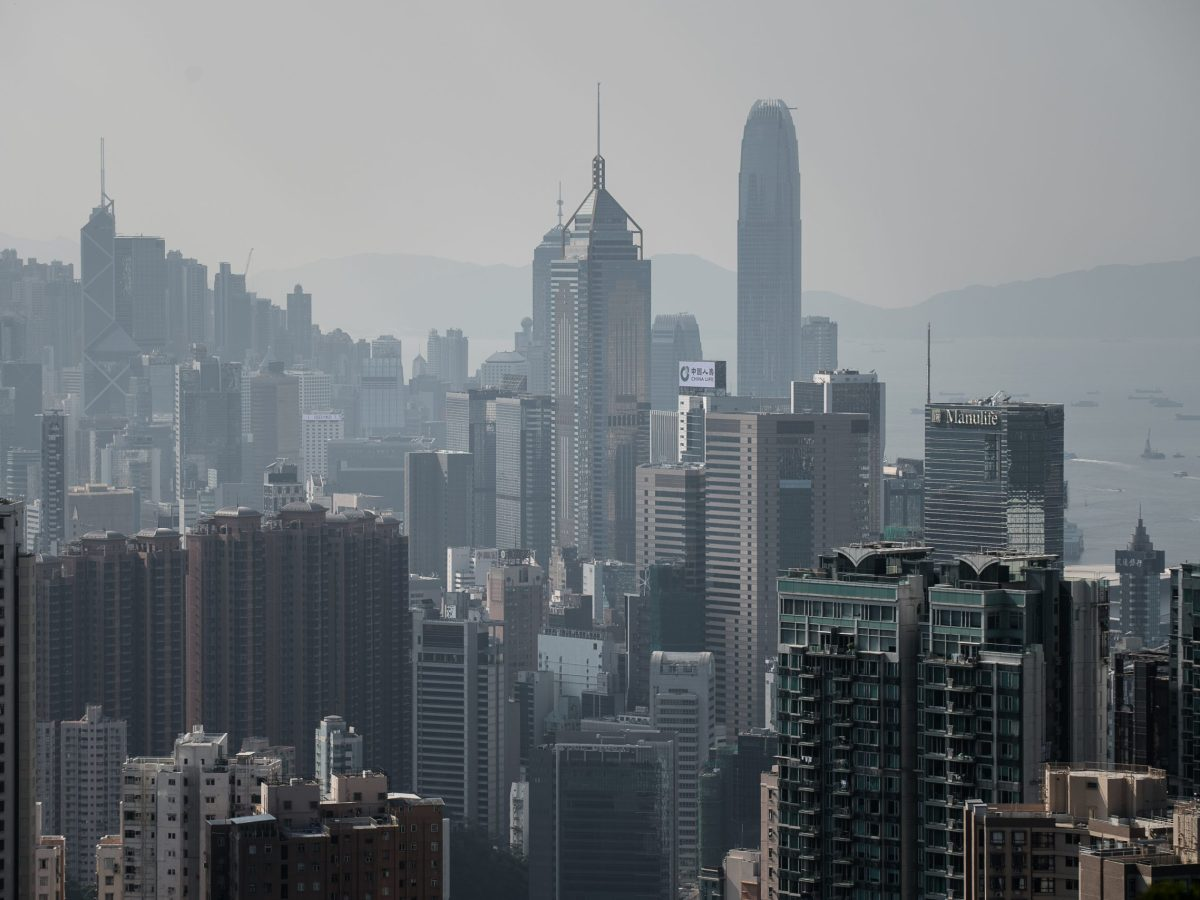 Paying off a 30-year mortgage on a median-price home in Hong Kong would cost a median-income buyer more than half of his or her income. Photo: AFP / Philippe