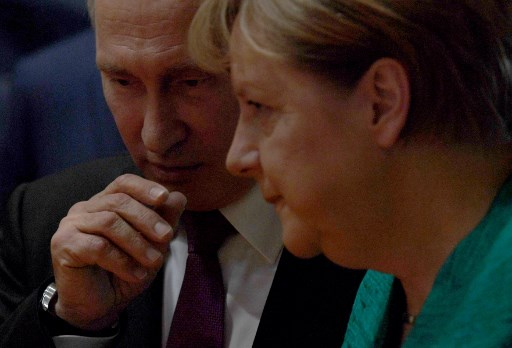 German Chancellor Angela Merkel talks with Russia's President Vladimir Putinas at the G20 summit in Hamburg. The latest round of US sanctions against Russia will likely force leaders to work more closely with Putin. Photo: AFP/Patrik Stollarz