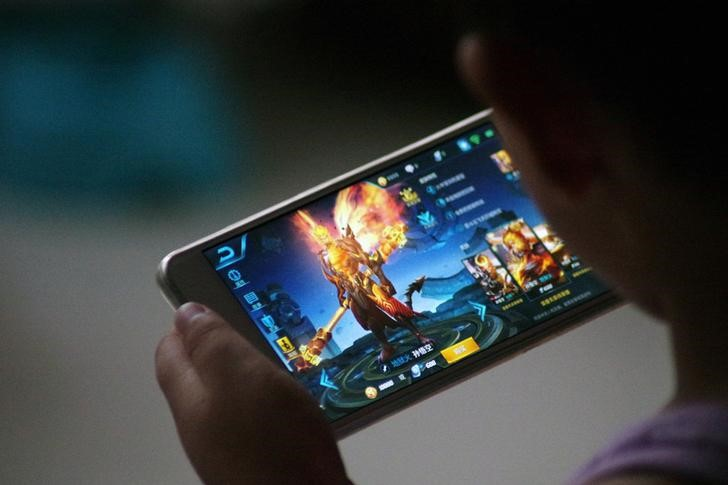 "A child plays the game ""Honour of Kings"" by Tencent. Photo: Reuters"