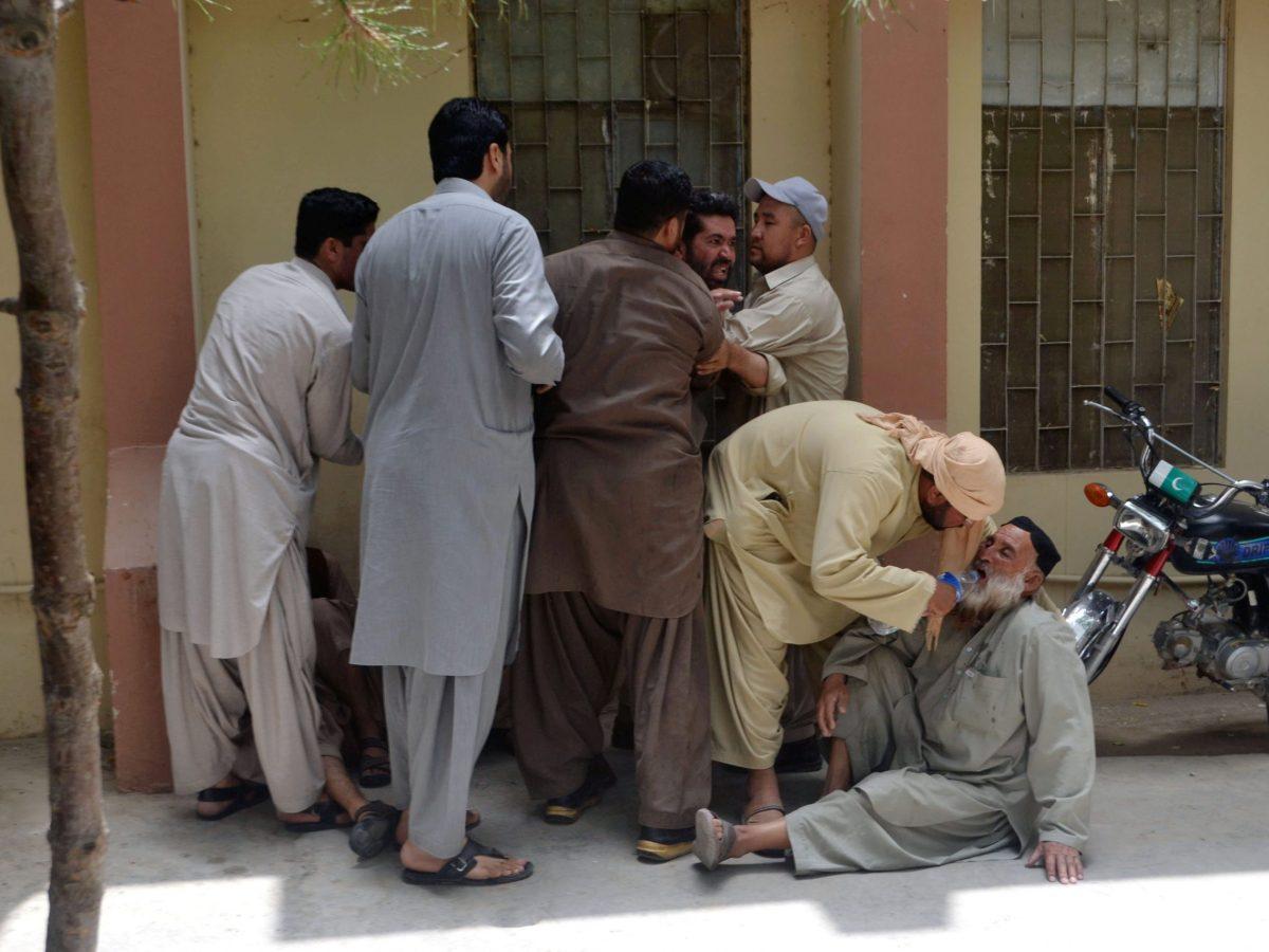 Relatives wait outside a hospital after policemen were shot dead in Quetta, Pakistan, on July 13, 2017. Photo: Reuters / Naseer Ahmed
