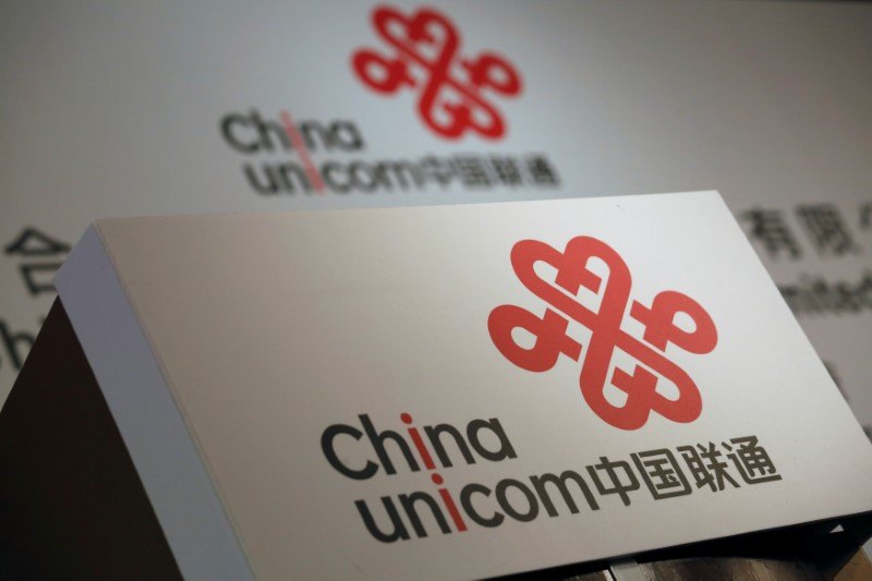 Company logos of China Unicom are displayed at a news conference during the company's announcement of its annual results in Hong Kong, China March 16, 2016. Photo: Reuters/Bobby Yip