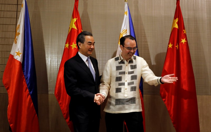 Philippine Foreign Affairs Secretary Alan Peter Cayetano escorts visiting China's Foreign Minister Wang Yi before a bilateral meeting in Manila on Tuesday. Photo: Reuters/Erik De Castro
