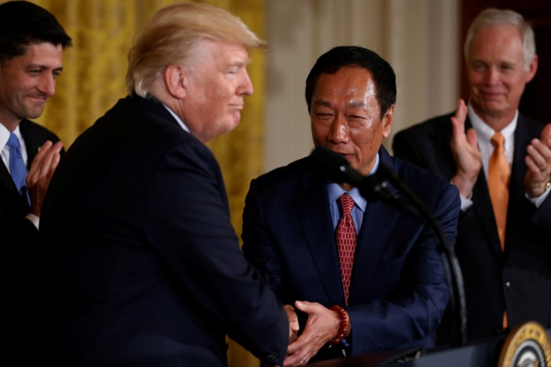 Foxconn Chairman Terry Gou shakes hands with US President Donald Trump during a White House event on Wednesday. Photo: Reuters/Jonathan Ernst