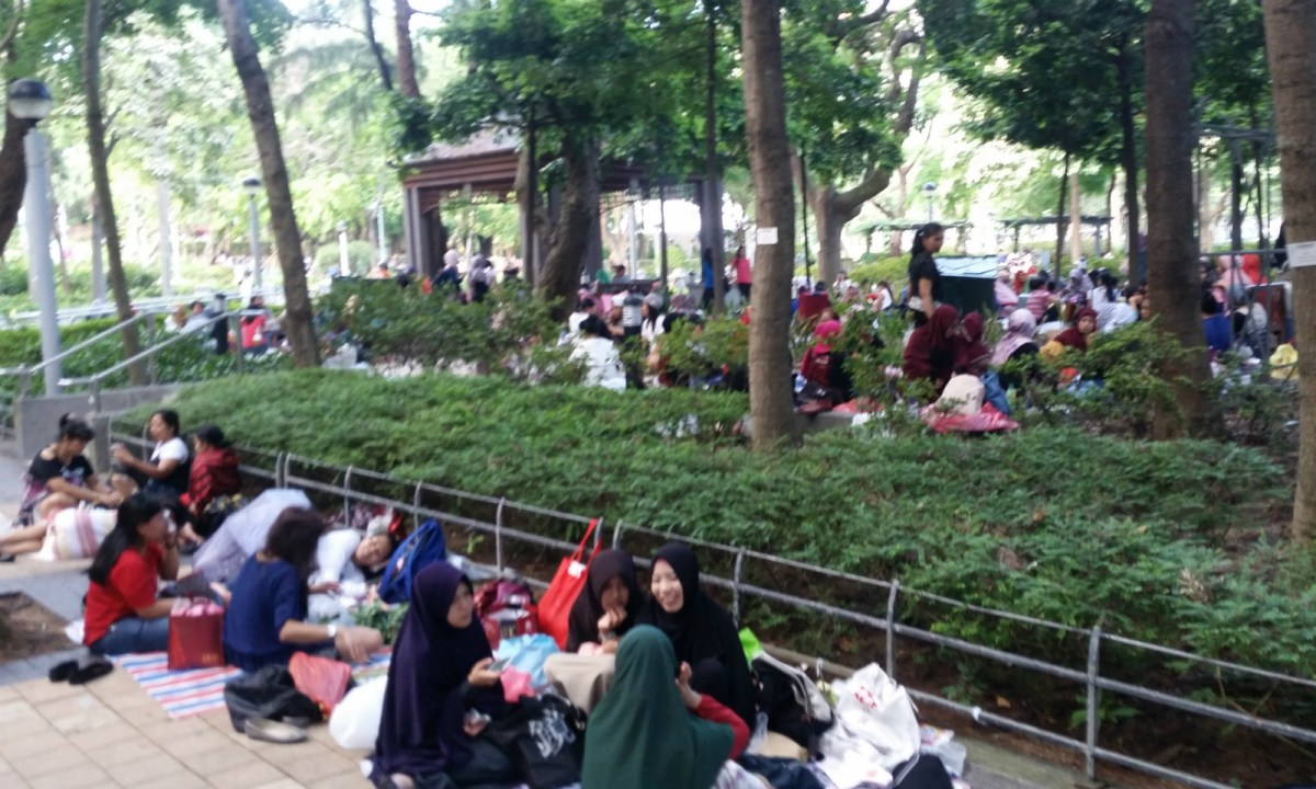 Indonesian maids rest in Victoria Park in Causeway Bay. Photo: Asia Times