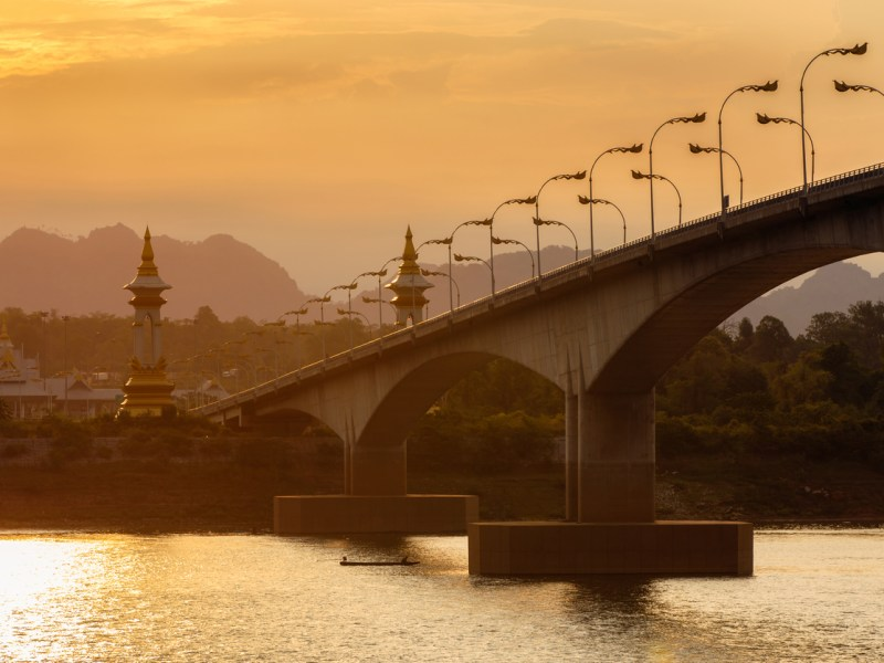 Stock image of the Third Thai - Lao Friendship Bridge at sunset time, Nakhon Phanom province, Thailand looking across the Mekong into Laos. Photo: iStock/Getty Images