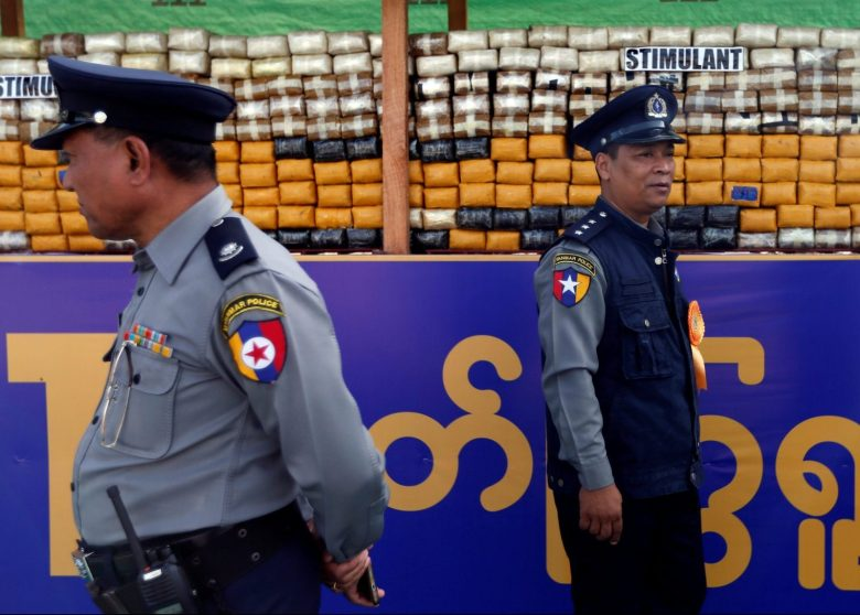 Police officers stand next to seized drugs that will be burned at an event to mark International Day against Drug Abuse and Illicit Trafficking, outside Yangon, Myanmar  June 26, 2017.  REUTERS/Soe Zeya Tun