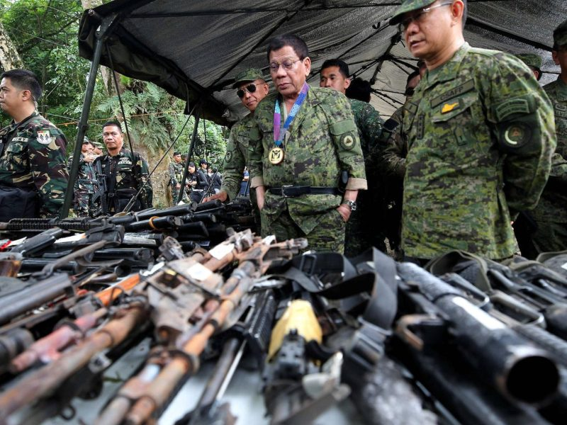 Philippine President Rodrigo Duterte inspects firearms together with Eduardo Ano, Chief of Staff of the Armed Forces of the Philippines (AFP), during his visit at the military camp in Marawi city, southern Philippines July 20, 2017. Presidential Palace/Handout via Reuters.