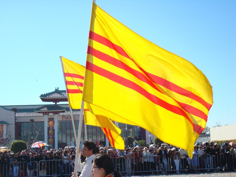Ethnic Vietnamese fly the flag of former South Vietnam in Orange Country, California. Photo: Wikimedia Commons