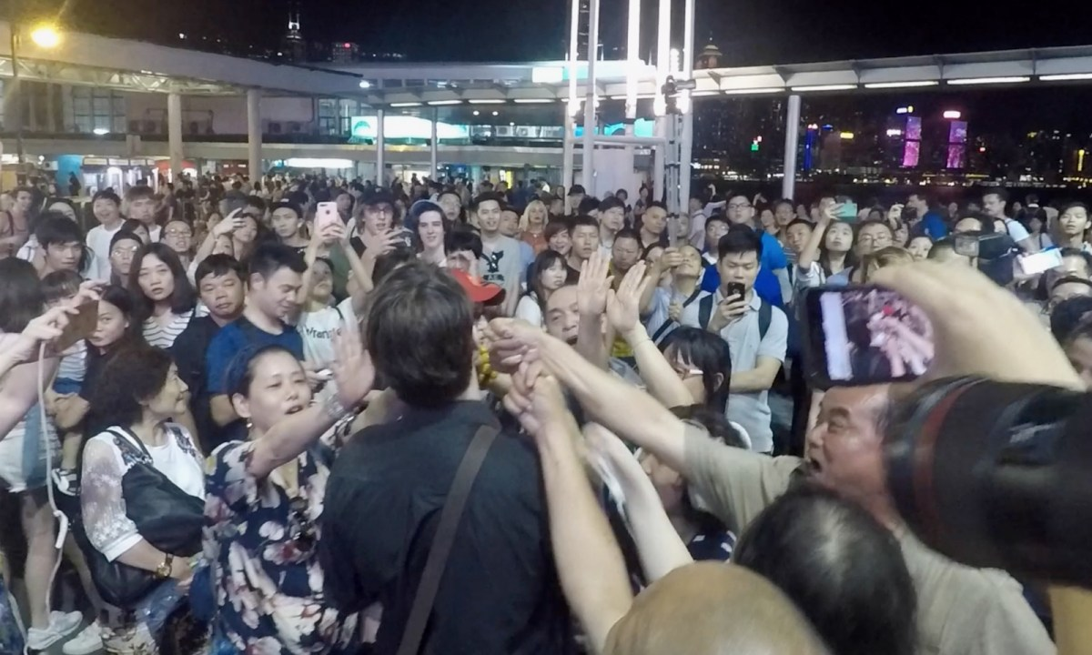 Angry pro-Beijing people swear at a British. Photo: Asia Times
