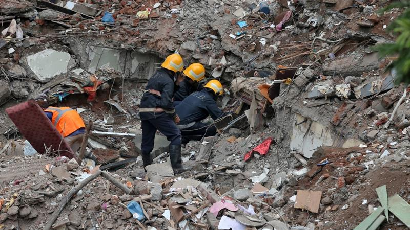 Rescuers sift through rubble in the hope of finding more survivors after the collapse of a residential building in the Mumbai suburb of  Ghatkopar on Tuesday. Photo: Reuters