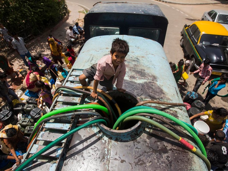 In many poor parts of New Delhi there is limited running water, and people need government water deliveries to beat the summer heat. Photo: iStock