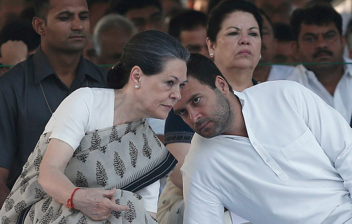 India's Congress party chief Sonia Gandhi (L) listens to her son Rahul Gandhi (R), at a family function in New Delhi.  Photo/Reuters/Files