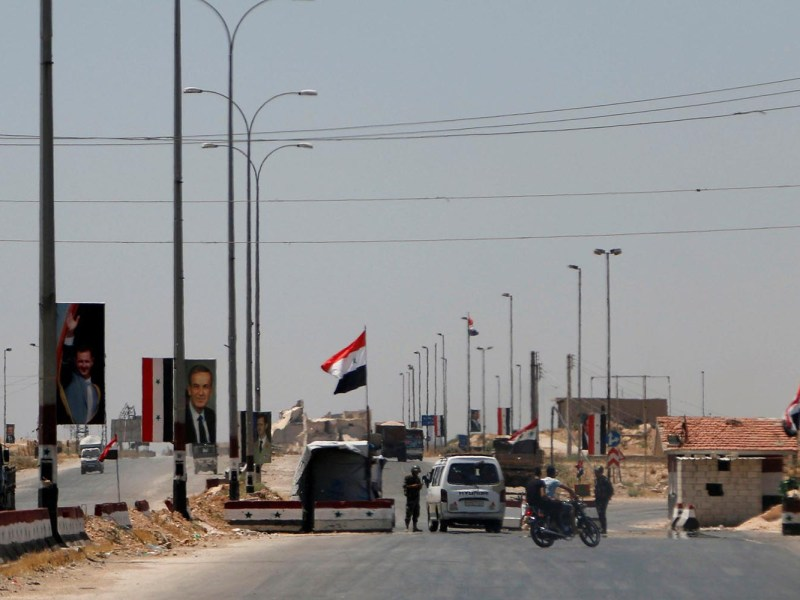 Road to Aleppo: The Chinese don't forget that Syria controlled overland access to both Europe and Africa in ancient Silk Road times. Syrian forces loyal to President Bashar al-Assad monitor traffic on the road to Aleppo in Syria on July 10, 2017. Photo: Reuters/Omar Sanadiki.
