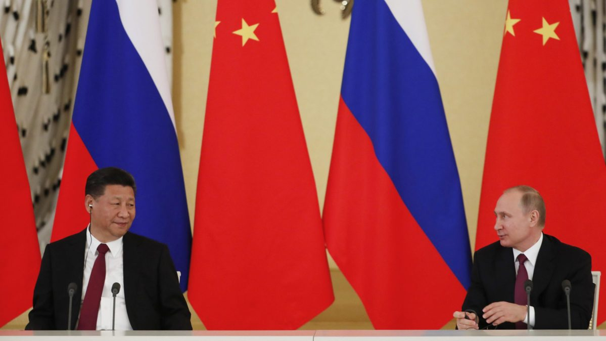 Russian President Vladimir Putin meets with his Chinese counterpart Xi Jinping at the Kremlin on July 4, 2017. Photo: Reuters/Sergei Ilnitsky/Pool