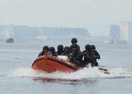 Members of a Philippine coast guard anti-terrorism unit ride on a speed boat as they hold a security drill. Photo: AFP/Ted Aljibe