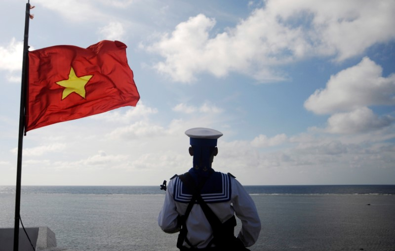 A Vietnamese naval soldier stands quard at Thuyen Chai island in the Spratly archipelago. Photo: Reuters/Quang Le