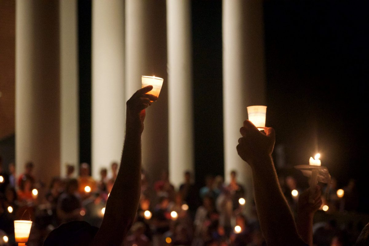 Members of the Charlottesville community hold a vigil for Heather Heyer following last Saturday's protest organized by white nationalists. Photo: Reuters/Kate Bellows/The Cavalier Daily